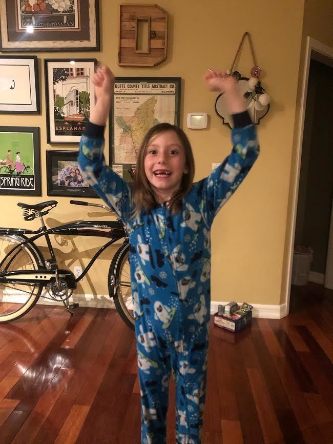 Finding out she gets to use a Chromebook for school work!